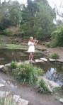 Rachael in the middle of a pond at video shoot